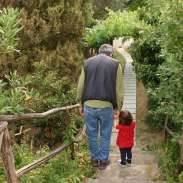 Maggie and Papa exploring Villa Cortonas grounds